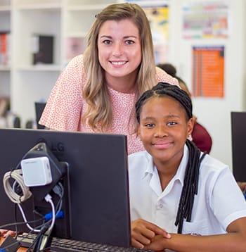 High school computer class student and teacher