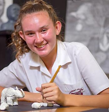 Smiling School Girl in Art Class