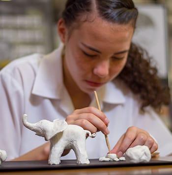 Student using sculpting tools